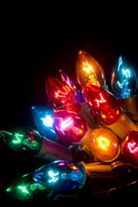 Brightly colored Christmas lights on a black background