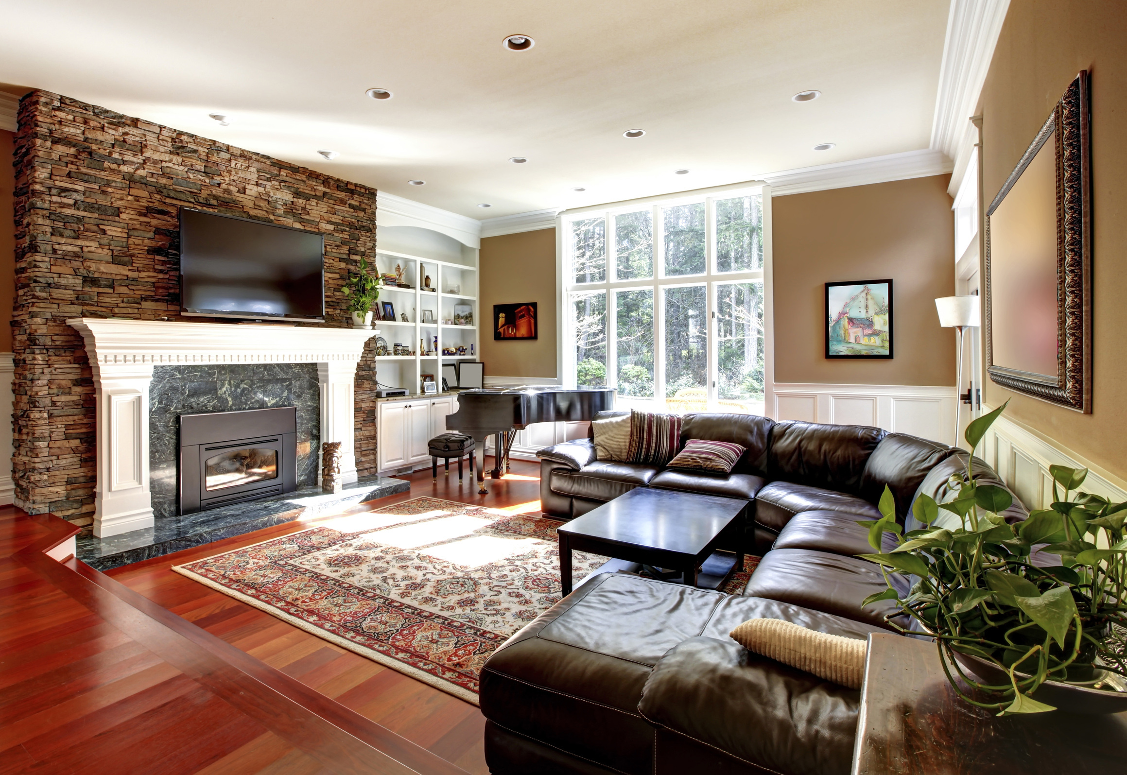 How to stage a home to sell - Luxury Living Room With Stobe Fireplace And Leather Sofas