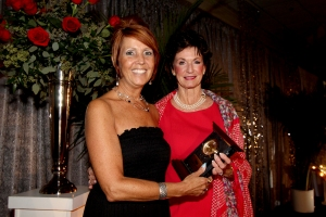 Pam Sibcy (right) is bestowing the 2014 Community Service award to Cyndi Scarpelli