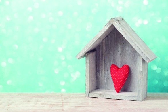 Valentine's day concept with heart shape and house over rustic b
