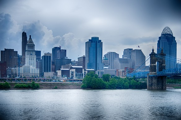 Cincinnati skyline. Image of Cincinnati skyline and historic John A. Roebling suspension bridge cross Ohio River.