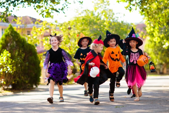 Kids trick or treat. Halloween fun for children.